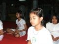 Thai Buddhist child is sitting the concentration happily.jpg